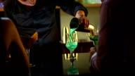 HD: Bartender Serving Cocktails