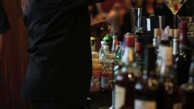 Bartender serving drinks at open bar
