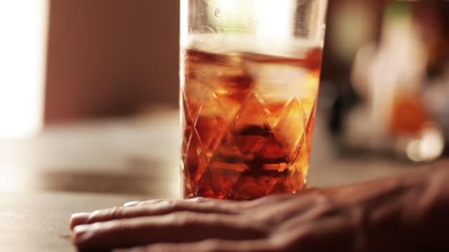 Bartender stirring mixed drink
