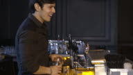 bartender working and talking to customers