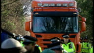 Barton Moss antifracking protest Police pushing protesters along road and protesters singing SOT / Police at side of road as protesters past / Badges...