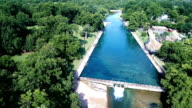 Barton Springs Austin Texas USA behind Day with waterfall and Crystal Clear Spring water swimming hole