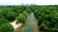 Barton Springs with Austin Cityscape Skyline Aerial Shot of Texas Hill Country Paradise 4K