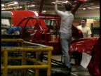 Base lending rate down / Mortgage cuts ITN LIB Ellesmere Port BV Men working on shell of car on production line GV Cars on production line with...