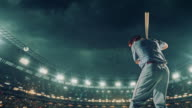 Baseball batter hitting a ball during game