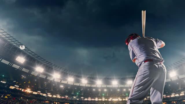 Baseball batter hitting ball during game