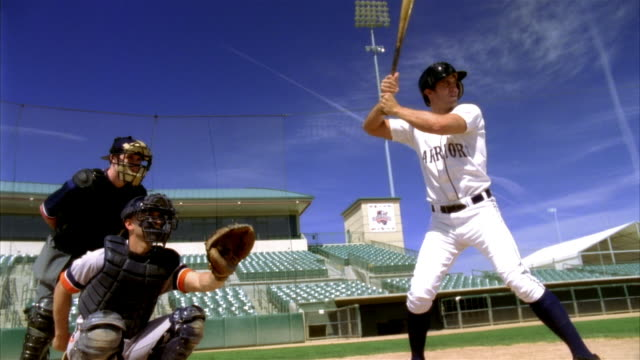 SLO MO MS Baseball batter hitting ball in stadium / Lancaster, California, USA