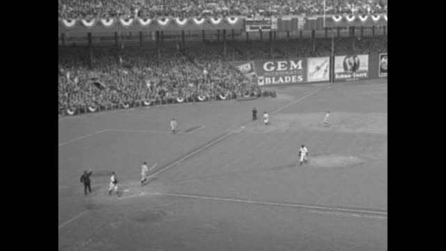 VS baseball game between Philadelphia Phillies and New York Giants at the Polo Grounds in New York city interspersed with crowd shots player draws a...