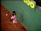 Baseball player jumps high to make tough catch deep in outfield
