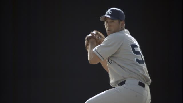 MS SLO MO Baseball player pitching ball / Thousand Oaks, California, USA