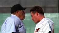 MS PROFILE baseball player + umpire arguing / umpire ejects player from game