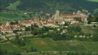AERIAL WS Basilique Ste-Madeleine and town atop hill with surrounding landscape / Vezelay, France