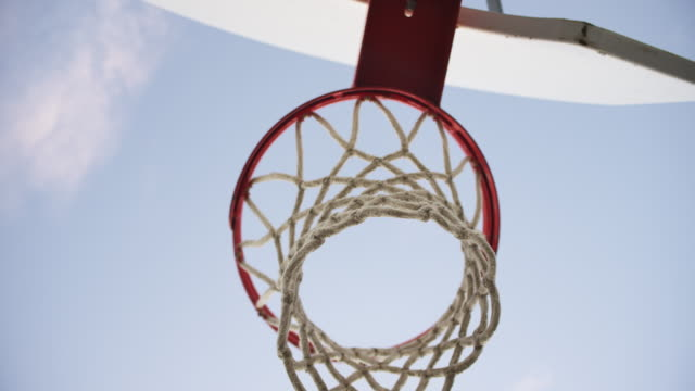 Basketball hits backboard and misses, slow motion