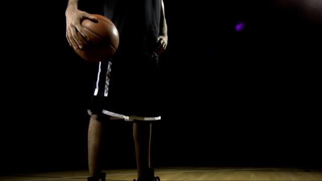 Basketball Player Posing With A Ball
