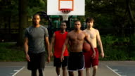Basketball Players Approach Camera