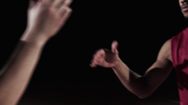 SLO MO of basketball players making a handshake
