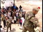 British troops maintain order ITN IRAQ Basra British soldier sitting in vehicle manning checkpoint watching cars pass CBV British soldier looking...