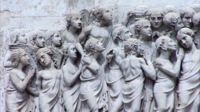 A bas-relief on the facade of Orvieto Cathedral features masses of sculptured figures. Available in HD.
