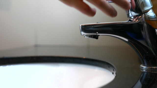 Bathroom tap turning on, running and turning off