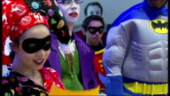 Batman fans audition for new show INT Girl dressed as Batman character queuing up to audition Anthony van Laast leading rehearsals Woman reading...