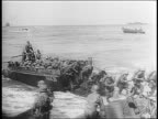 Battle of the Central Pacific / Marines storm shore from Higgins landing barges / Marines running through the water and onto the beaches / dead...