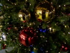 Baubles and fairy lights on an artificial Christmas tree