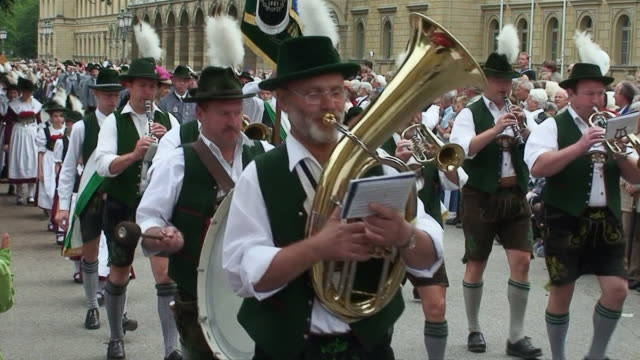 MS Bavarian brass band marching, following by others at opening of Oktoberfest / Munich, Bavaria, Germany