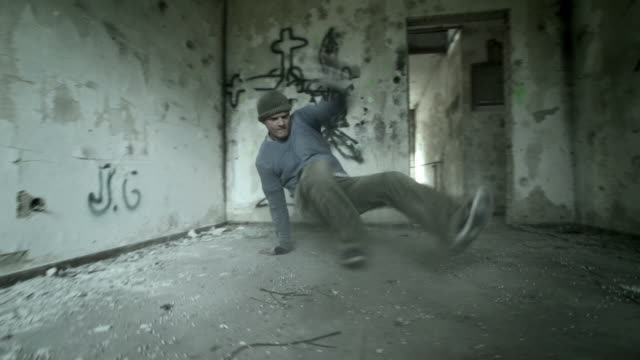 HD: B-Boy Performing Power Moves In Obsolete Building