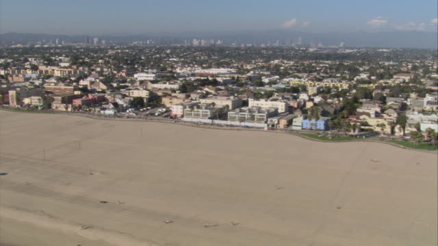 AERIAL Beach houses and businesses off Venice Beach in Los Angeles / Venice Beach, California, United States
