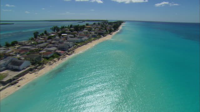 LOW AERIAL Beach houses in Alicetown, Bimini island, Bahamas