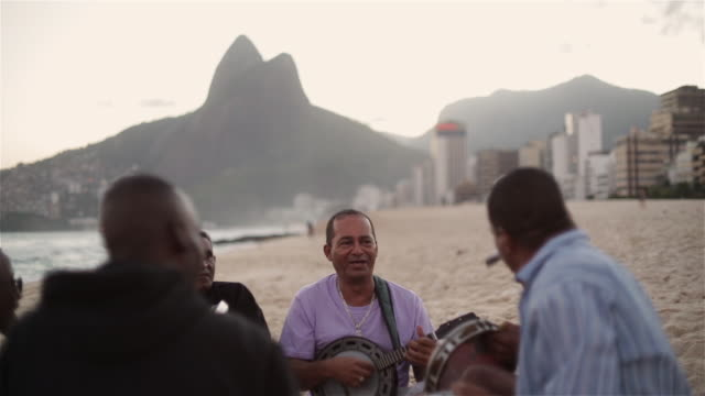 MS, R/F Beach musicians sing and play instruments on Ipanema beach / Rio de Janeiro, Brazil