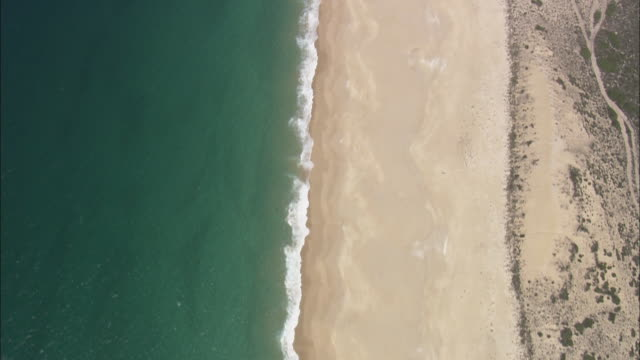 AERIAL WS Beach viewed from above / Sines, Setubal, Portugal