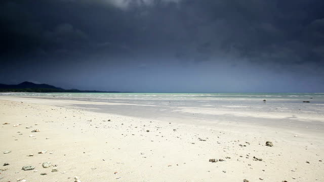 Beach with stormy clouds
