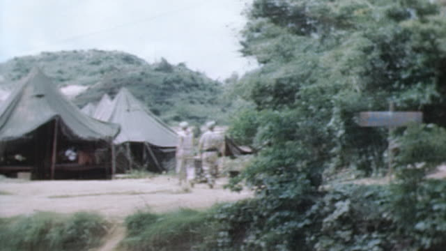 PAN Beachfront military camp tents supplies and vehicles / Okinawa Japan