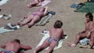 HA Beachgoers sunning / United Kingdom