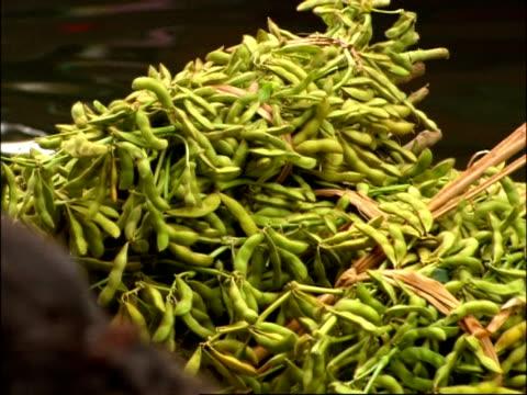 CU of Beans on boat at floating markets, Bangkok, Thailand