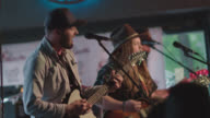 Bearded country rock band play in Austin bar during South By Southwest music festival