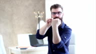 Bearded hipster businessman showing middle finger