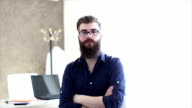 Bearded hipster student being interviewed for a job