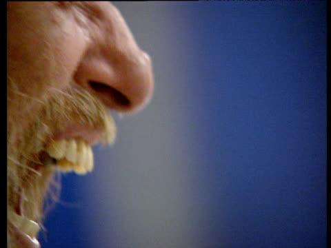 Bearded man crying into hand