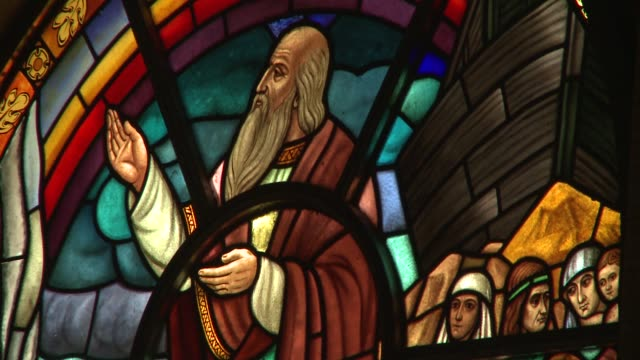 A bearded saint raises his hand toward the sky on a stained glass window in Addis Ababa, Ethiopia. Available in HD.