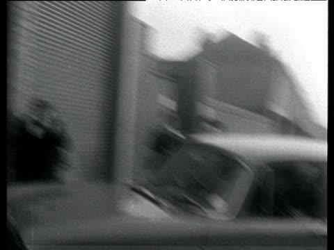 Beatles fans run down street and around car police usher car through garage girls left screaming Birmingham 1963