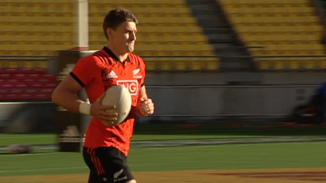 Beauden Barrett running and catching ball during New Zealand All Blacks rugby training at Westpac Stadium in Wellington in 2017