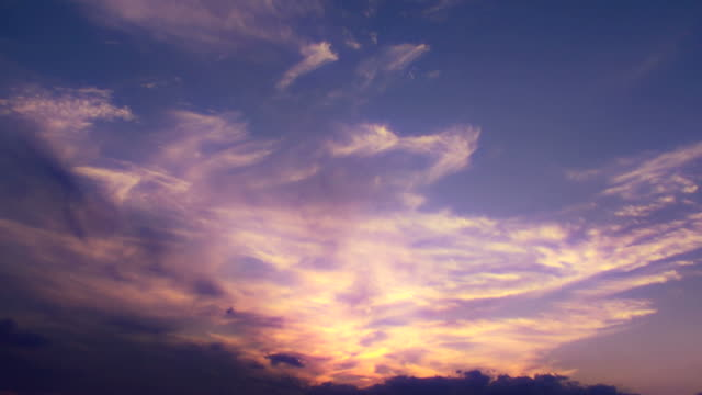 Beautiful angelic clouds flow quietly after sunset