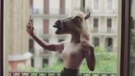 Beautiful black woman take a selfie with horse head