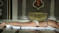 Beautiful Blonde in Roman Bath