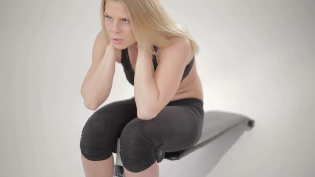 Beautiful blonde woman doing sit-ups