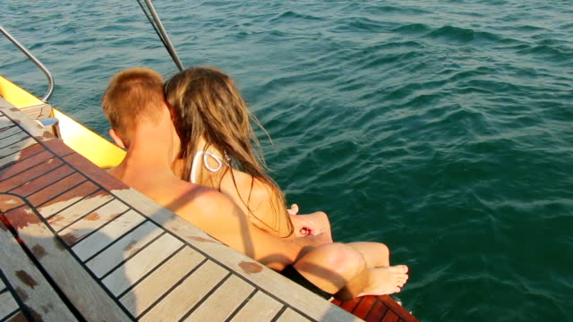 beautiful couple relaxing on a yacht