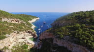 AERIAL Beautiful Dalmatian bay Stiniva on Vis island