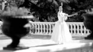 beautiful dancing ballerina on the terrace in the park